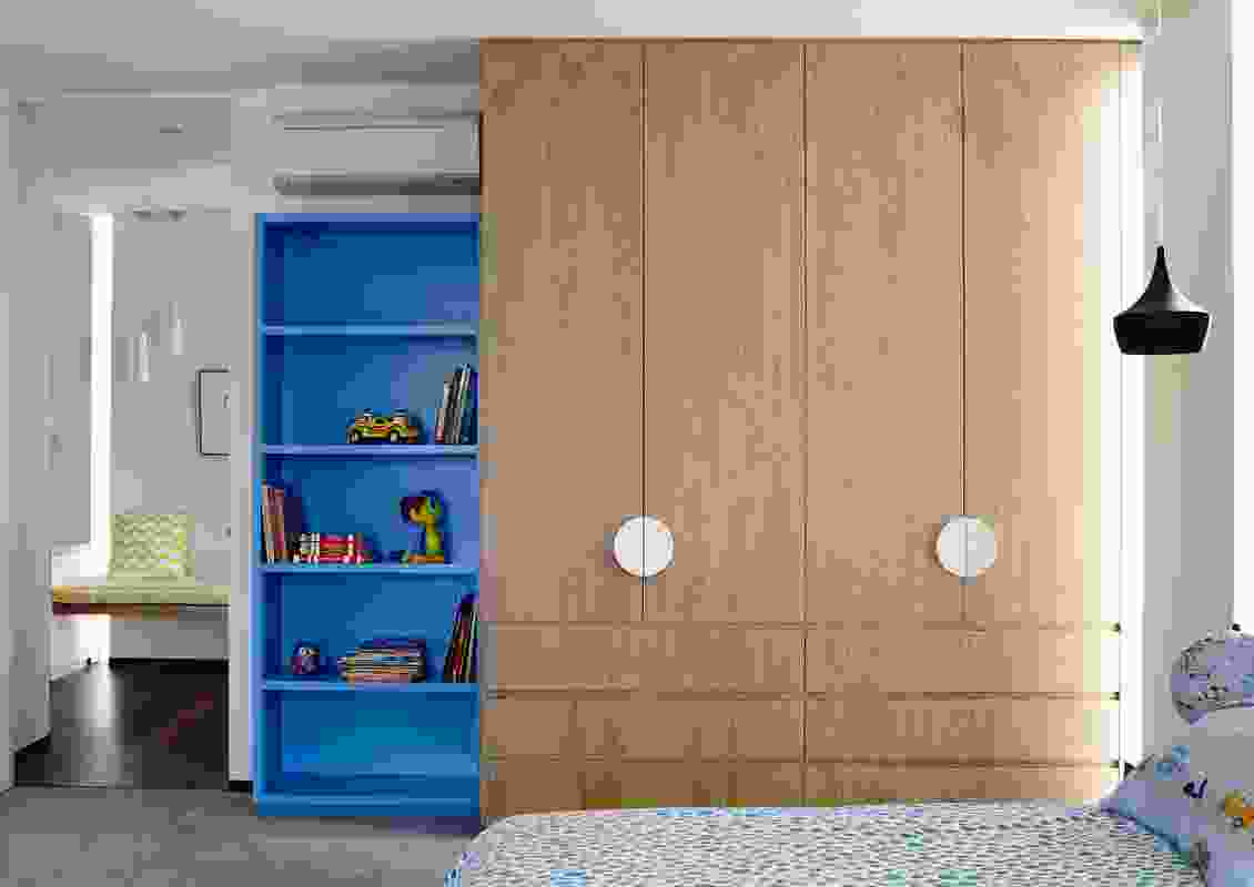 Bold colour and confident geometry define the  children's rooms.
