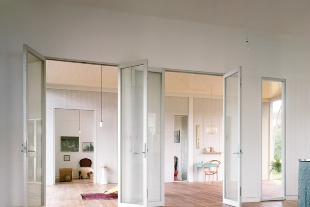 "Sets of identical doors align, framing long views across the rooms, portico and courtyard, ""which are arranged as a matrix of squares and golden sections."""