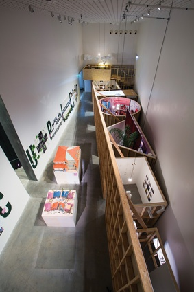 "The Occupied exhibition was held in a narrow space at the RMIT Design Hub in Melbourne, cleft by an exposed stud wall with ""interior"" rooms behind."
