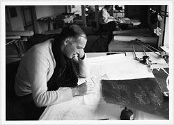 Jørn Utzon making a sketch for the auditorium ceiling design at Yuzo Mikami's drawing board, 1960. Utzon studio, Hellebæk, North Zealand. Photograph by Yuzo Mikami.