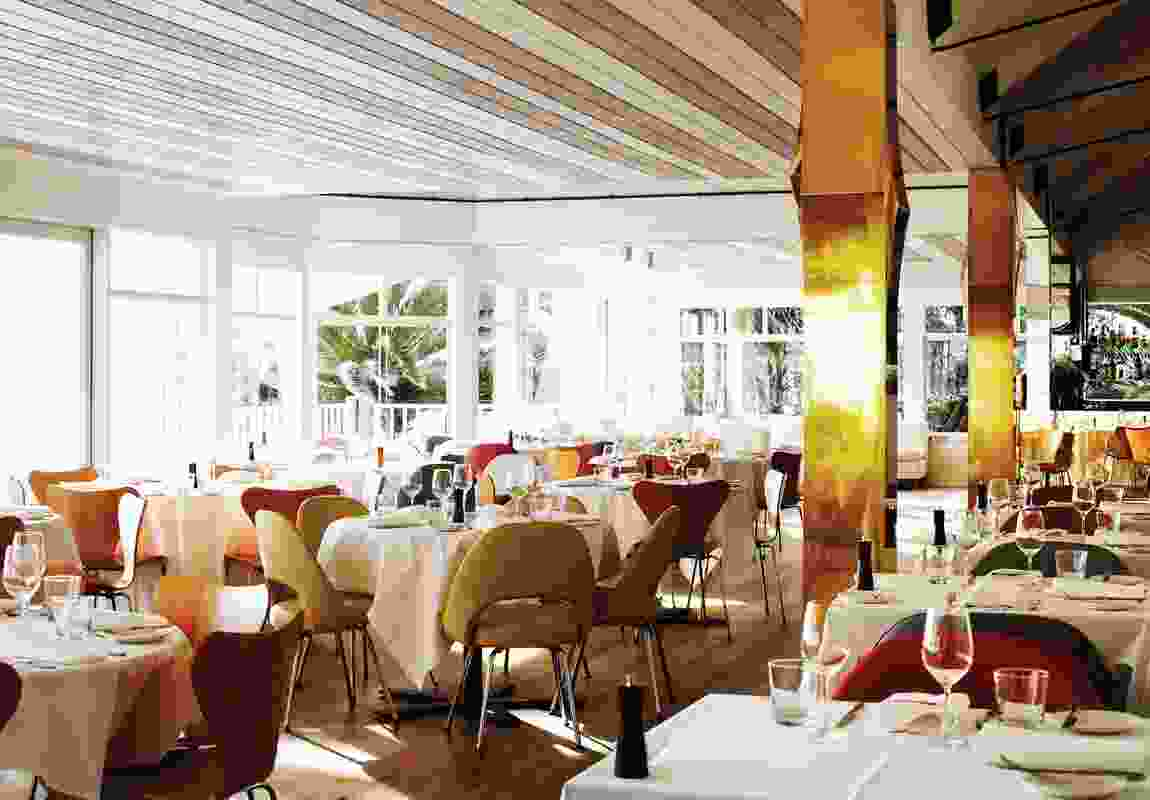 The main dining room is open and light with character provided in the colour and material choices.