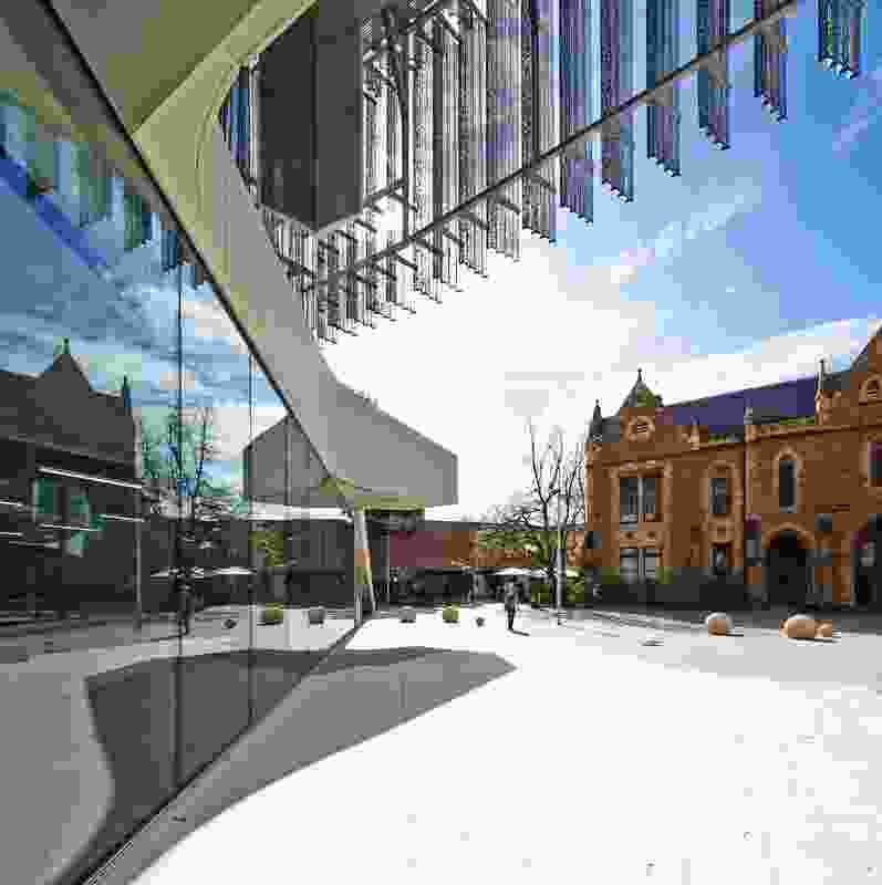 Openings in the building engage with the existing context of the University of Melbourne campus, including the Elisabeth Murdoch building.