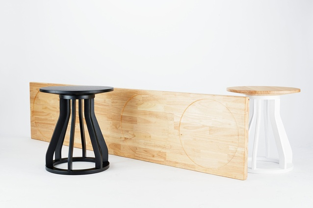 Jon Goulder Plank Bench with black and white Spool Stools.
