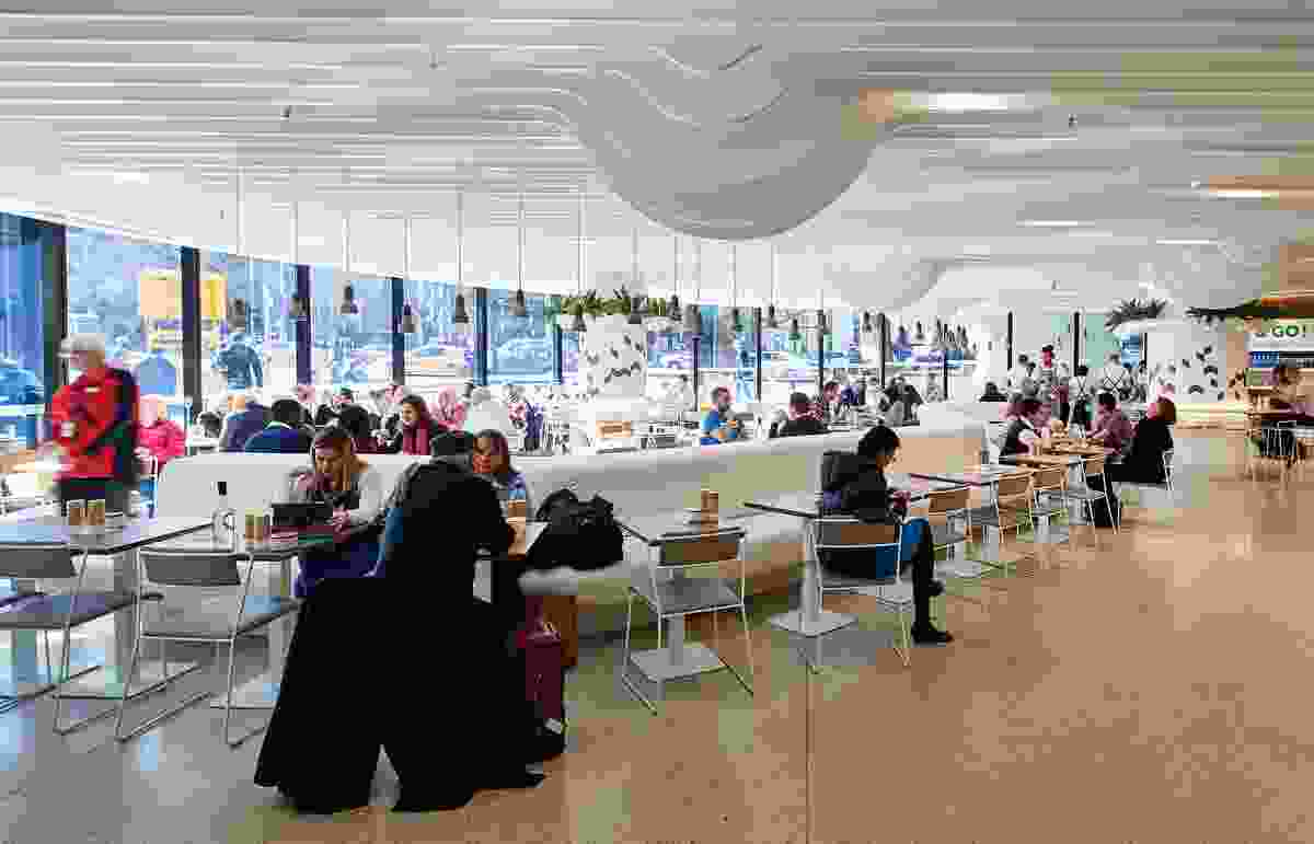 The ground level has been programmed to integrate semipublic spaces such as cafes and retail outlets.