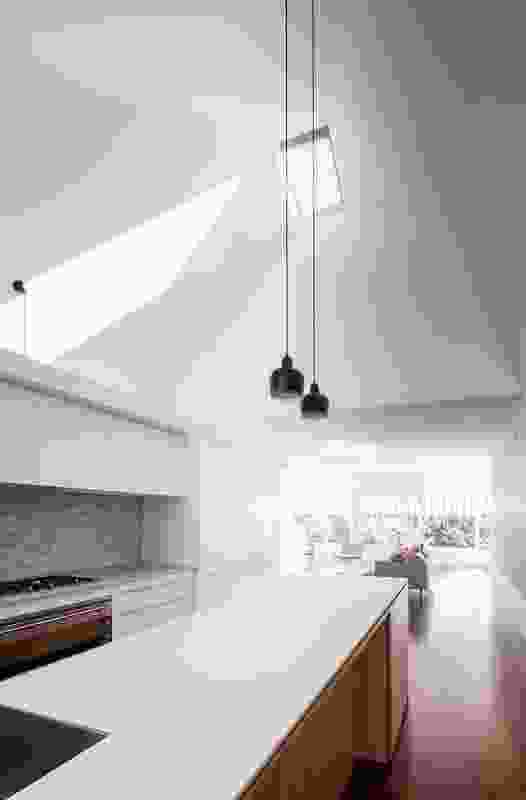 The faceted kitchen skylight adds another dimension to the space.