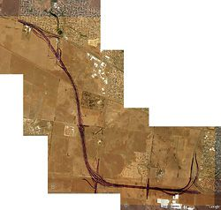 N°2 Composite view, showing the route of the bypass through the volcanic plains of western Melbourne. The road curves away from residential areas into a semi-rural industrial landscape. Aerial image from Google Earth.