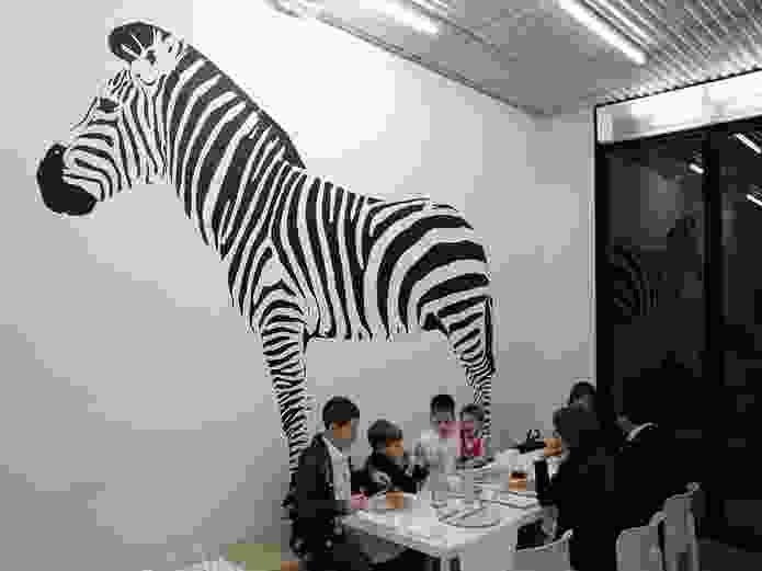 The opposite wall of Pizza Perez shows a  large zebra, popular with children.