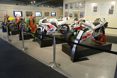 The collection of historic Grand Prix motor bikes is mounted on a series of flexible Drama Boxes, which can be rearranged to suit display requirements.