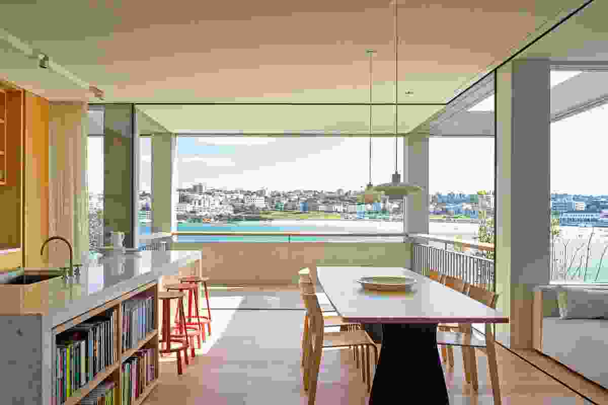 Slide-away glazed walls in the main kitchen and dining room allow an abundance of ventilation.