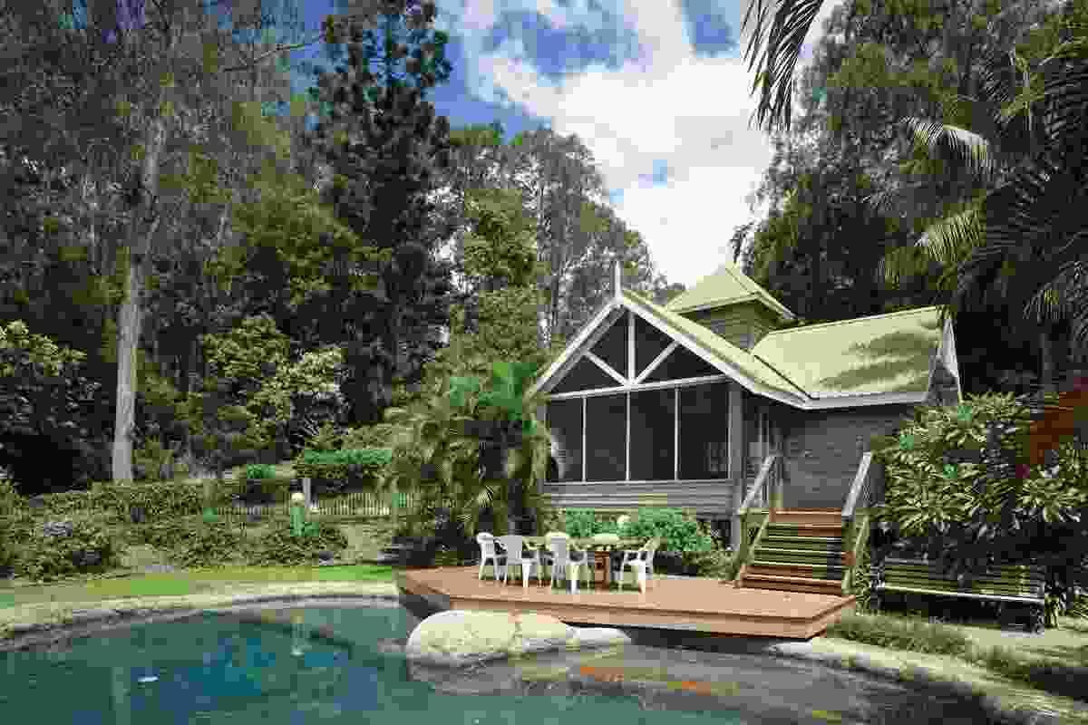 A summerhouse sits adjacent to the billabong-like pool.