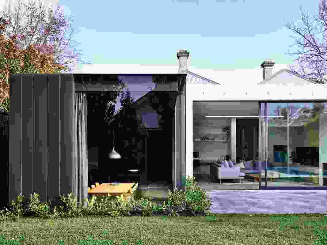 The split level within the extension is reinforced through a bold shift in colour and materials.