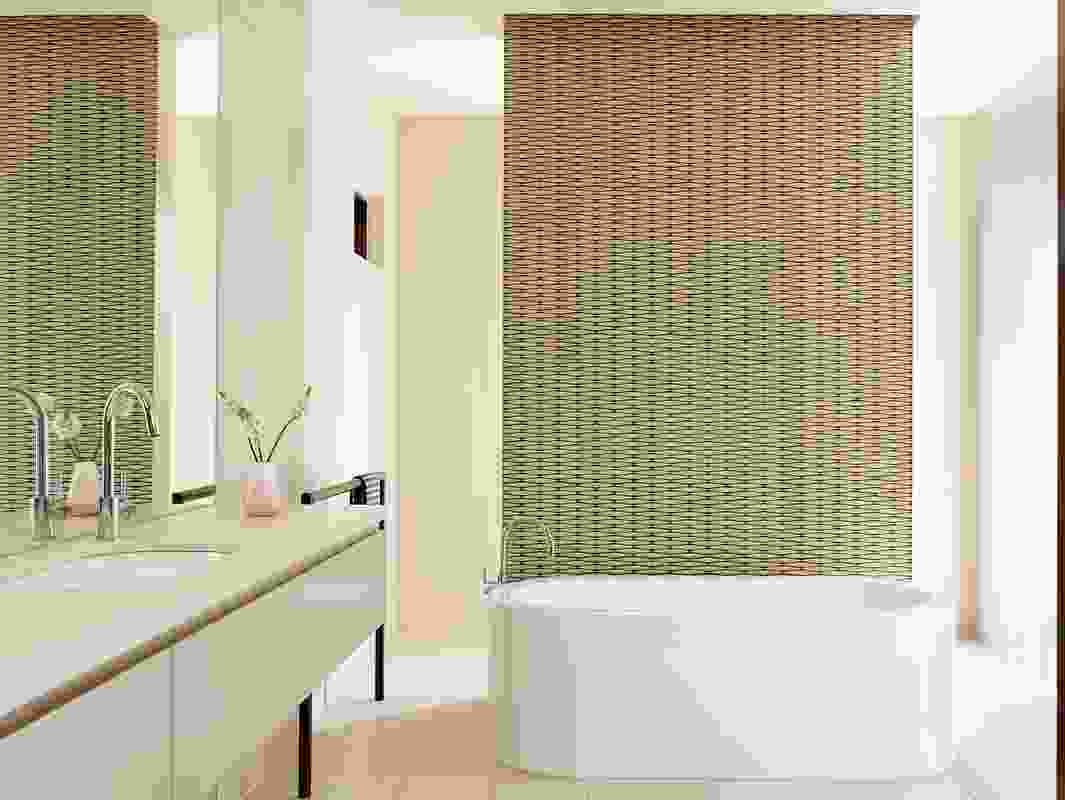 The richly textured ensuite has a three-dimensional tiled wall behind a free-standing bath.
