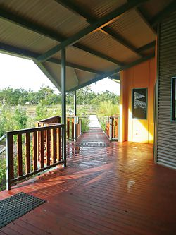 Ramp from car park leading to the lofty breezeway. The varied verandah spaces can serve as waiting and discussion areas.Image: Wendy Christie