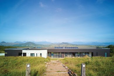 This long and simple house is tucked into the slope, so that on arrival from above, the views are paramount.