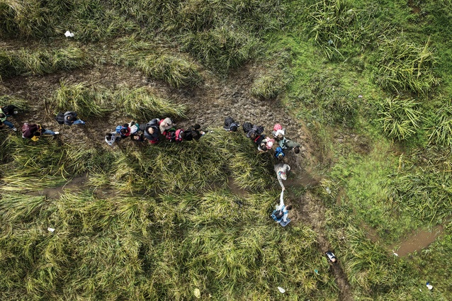 """A scene from the European refugee crisis: a Syrian man helps a woman cross a bog between the Macedonian town of Tabanovce and Preševo, Serbia. Juhani Pallasmaa asks, """"Have we entered an era of mass migration?"""""""