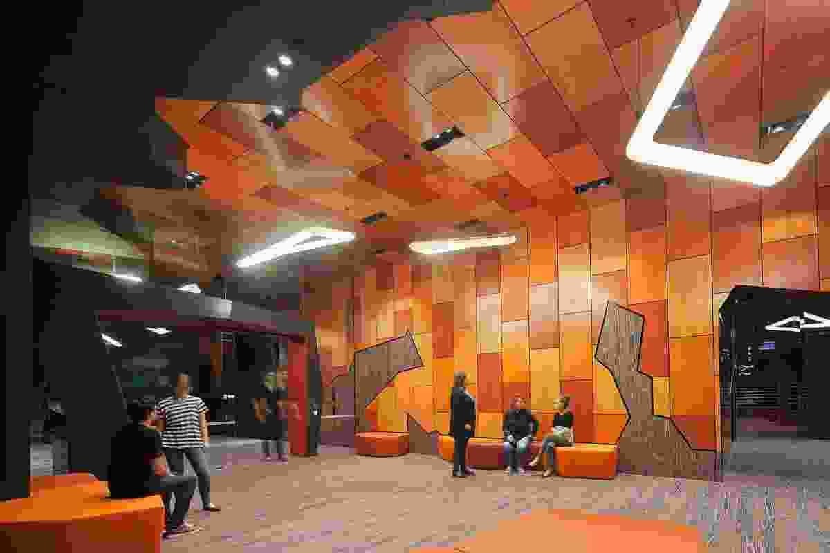 A generated Voronoi pattern was used to create the form and shapes in the foyer. The red and orange tones reference the colours of the topographic facade.