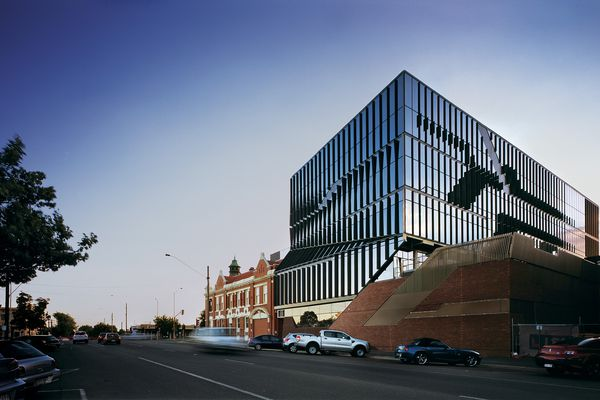At the BRICC, a glazed, five-storey facility adjoins a red brick building on the corner of Sturt and Drummond Streets.