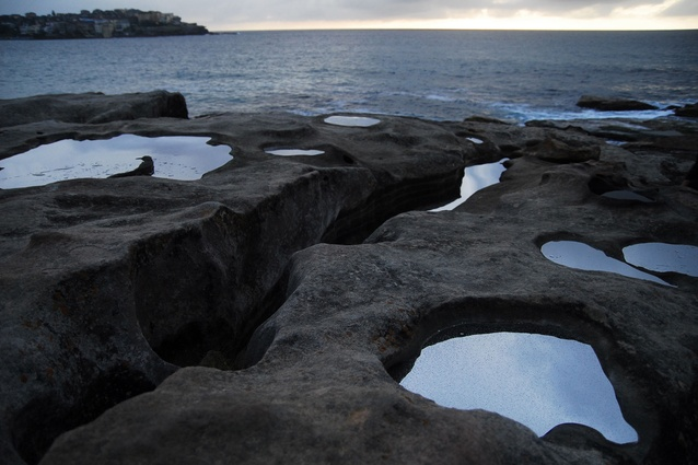 Lucy Humphrey's <em>Alchemy</em> 2009 used mirror-polished steel to mimick water in rockpools.