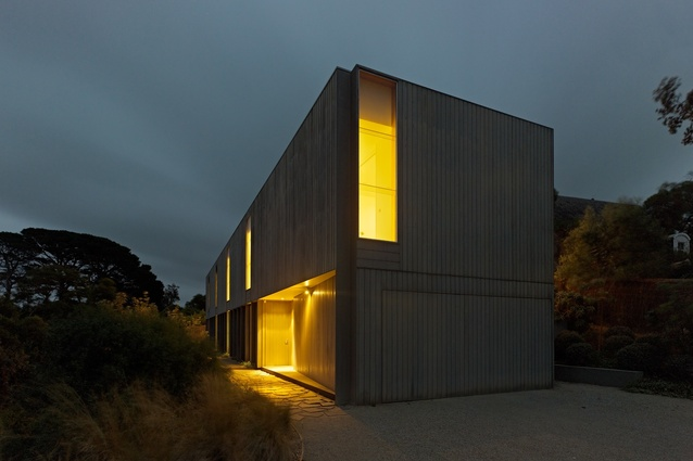 The nigh view illuminates the front entry –obscured by day.