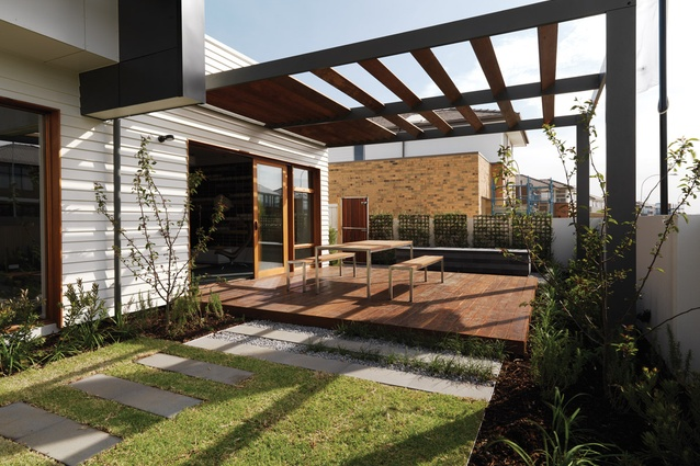 The living room spills out onto an outdoor dining area.