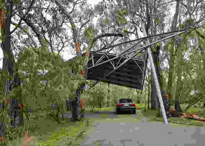 The standalone carport was designed in 1988 by Wood Marsh in a similar language to that of the house itself.