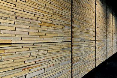 Discarded books live anew as a wall in Deakin Waurn Ponds Library by Six Degrees Architects.
