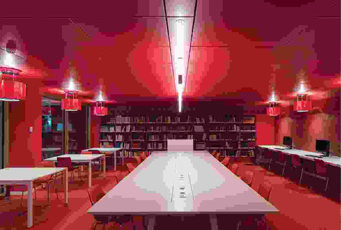 Among the white walls and wooden trimmings that dominate the interior are splashes of colour, like a red reading room where visitors can review old or rare publications.