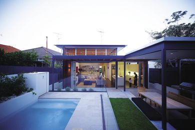 The rear of the bungalow embraces a connection to the outdoors.