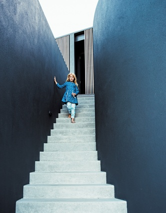 A necessary double-height retaining wall has been transformed into a dramatic entry sequence.