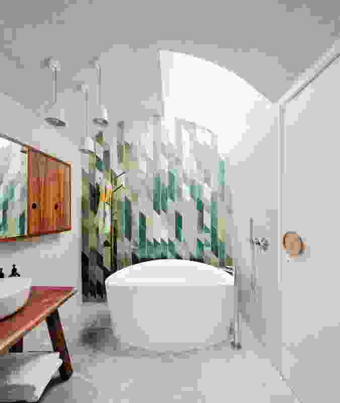 The clients were involved in the making of custom pieces, including the mosaic bathroom tiles.