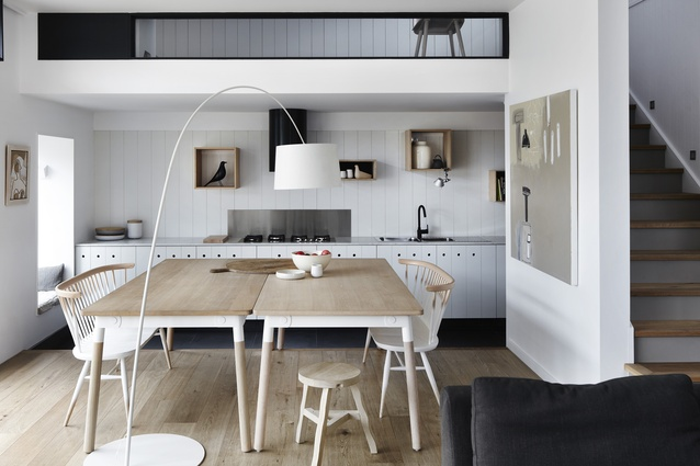 The dining table acts as the hearth of the home.