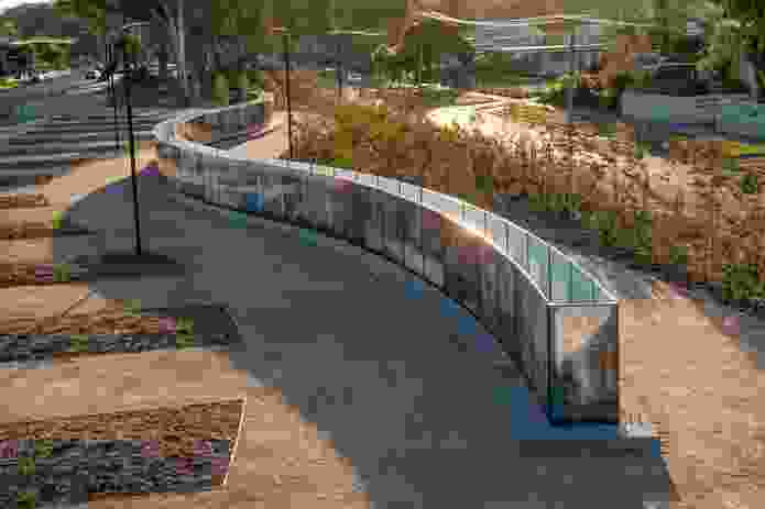 The commemorative wall curves elegantly through Seymour's landscape.