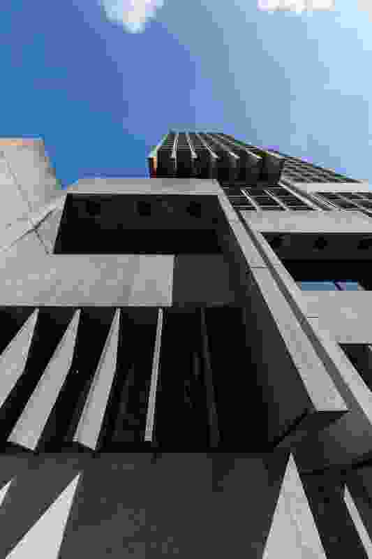 The original 23-storey tower was designed by Ancher Mortlock and Woolley in 1977.