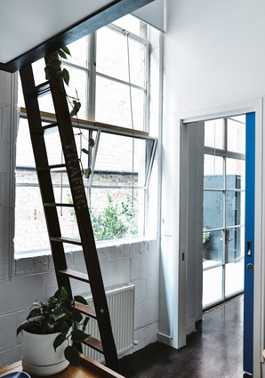 In one private office, a ladder steps up to a neat loft that takes advantage of the 4.5-metre ceilings.