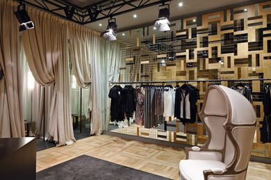 The solid timber parquetry is interspersed with mirror inlays towards the changing rooms.