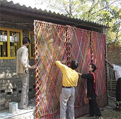 Installing a screen at a bholu preschool by Architects Without Frontiers, Ahmedabad, India.