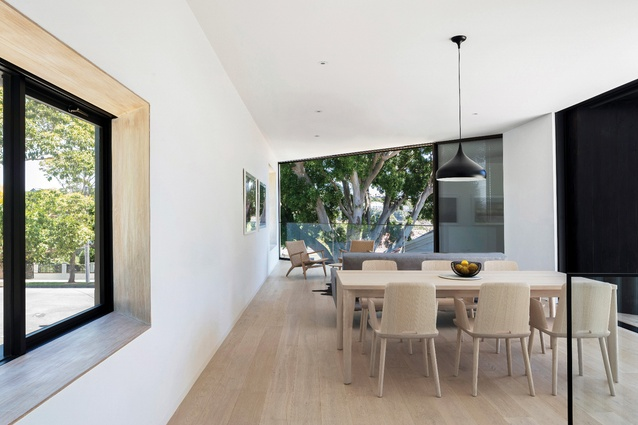 The upper-level volume is punctuated with generous openings that mediate the boundary between inside and outside.
