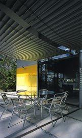 Draped aluminium slats proved secondary shelter for the garden table.Image: Jon Linkins