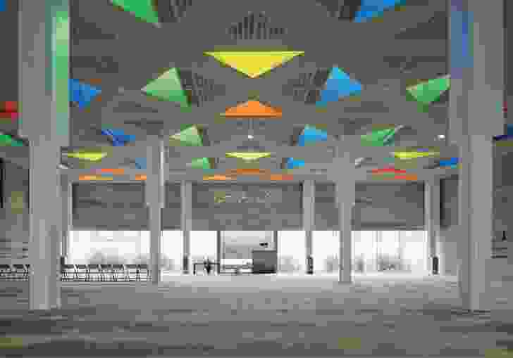 In place of a dome, the building features a flat roof punctured with a series of coloured lanterns that admit natural light to the prayer hall.