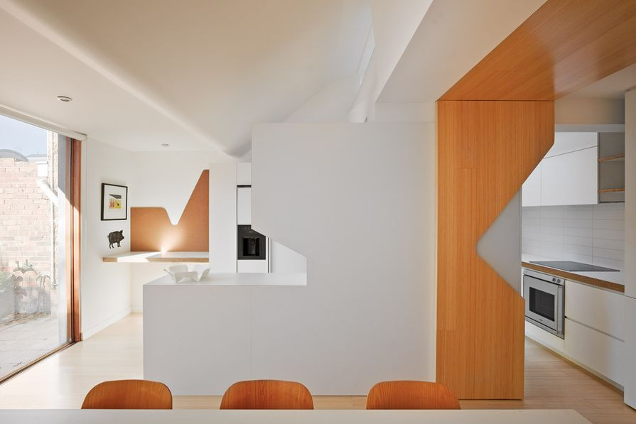 The eastern end of the house is characterized by cut-out shapes, spaces that fold into each other and natural light mediated by double glazing.
