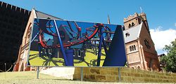 Callum Morton's billboard shows St Georges Cathedral as a roller-coaster ride.