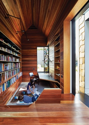 The library is sunken into the ground and provides a vantage point through to the courtyard. Stained glass window: Leigh Schellekens.