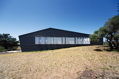 The western elevation of the Venus Bay House makes a bold, graphic gesture.
