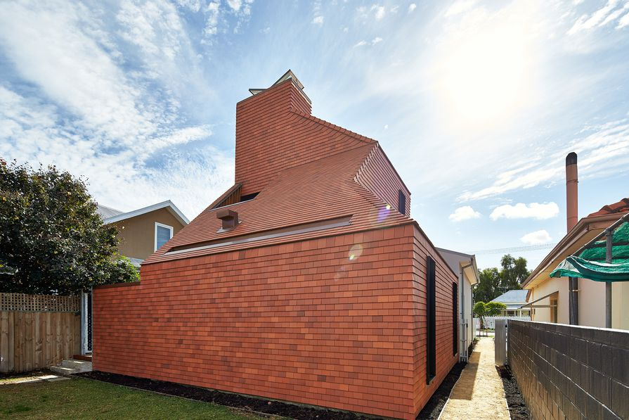 Designed in the manner of an oast, the extension is a reference to the industrious local migrant community.