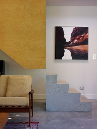 The detailing of the staircase makes a statement within the informal living room. Artwork: Neil Frazer, Gully #4, 2005.