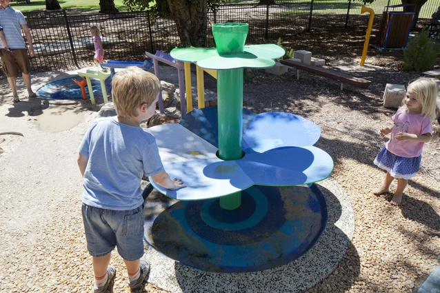 Water play provides sensory stimulation and cool relief on a hot day.