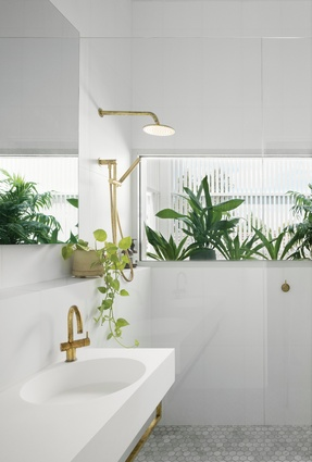 A panoramic window brings light into the main bathroom and provides a view of the street.