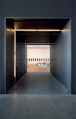The thick zinc walls that form the entries to the galleries also provide storage areas for artworks.