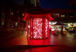A seating pagoda in Sydney's Chinatown has been transformed into a patterned red lantern that houses tourist information. Designed by Lacoste + Stevenson and Frost* Design.