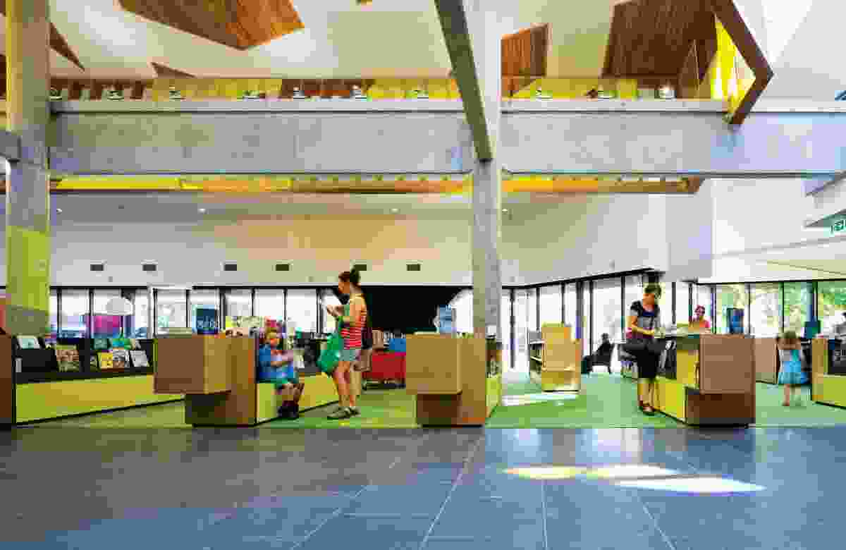 An internal street slices through the library, with a cafe, community lounge and children's area overlooking the park.